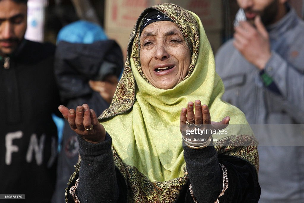 A Kashmiri Muslim woman prays outside the shrine of Sufi saint Naqashband Sahib, on January 16, 2013 in Srinagar, India. Thousands of People gathered to offer prayers marking the birth anniversary of the Sufi saint Naqashband Sahib at his shrine.