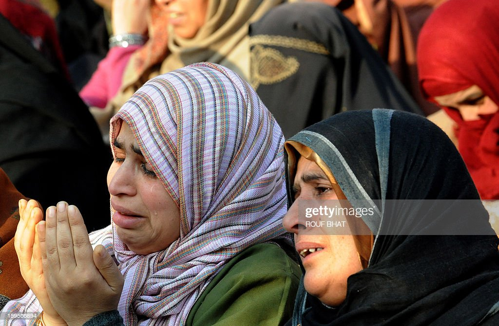 A Kashmiri Muslim woman weeps as she offers prayers at the shrine of Sufi saint Naqashband Sahib during an annual festival in downtown Srinagar on January 16, 2013. Thousands of people gathered to offer prayers marking the birth anniversary of Sufi saint Naqashband Sahib at his shrine in Srinagar. AFP PHOTO/ Rouf BHAT