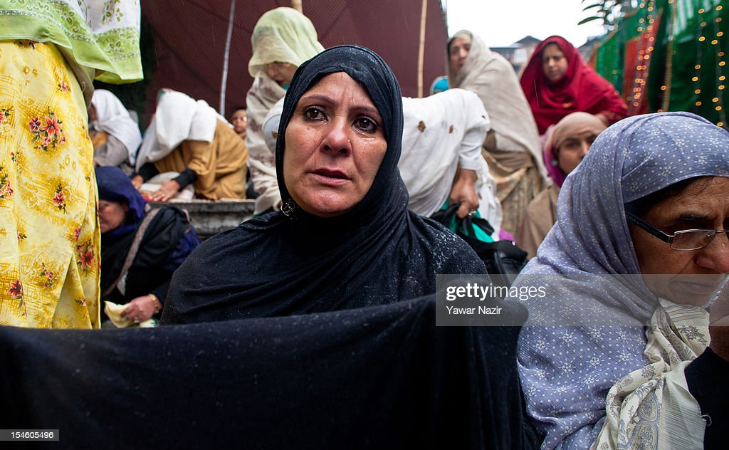 A Kashmiri Muslim woman weeps while praying at the shrine of Khaniqahi mullah during a festival on October 23, 2012 in Srinagar, the summer capital of Indian administered Kashmir, India. Thousands of Muslims thronged to the shrine of Mir Syed Ali Hamadan to commemorate the anniversary of the death of the Sufi saint, Hamadan. He is believed to be responsible for the spread of Islam in Kashmir. The shrine gains a special significance on 6th of Zilhaj (last month of Muslim calendar), the death anniversary of Mir Syed Ali Hamadan. On this day, devotees visit the shrine in large numbers to pay a tribute to saint Hamadan.