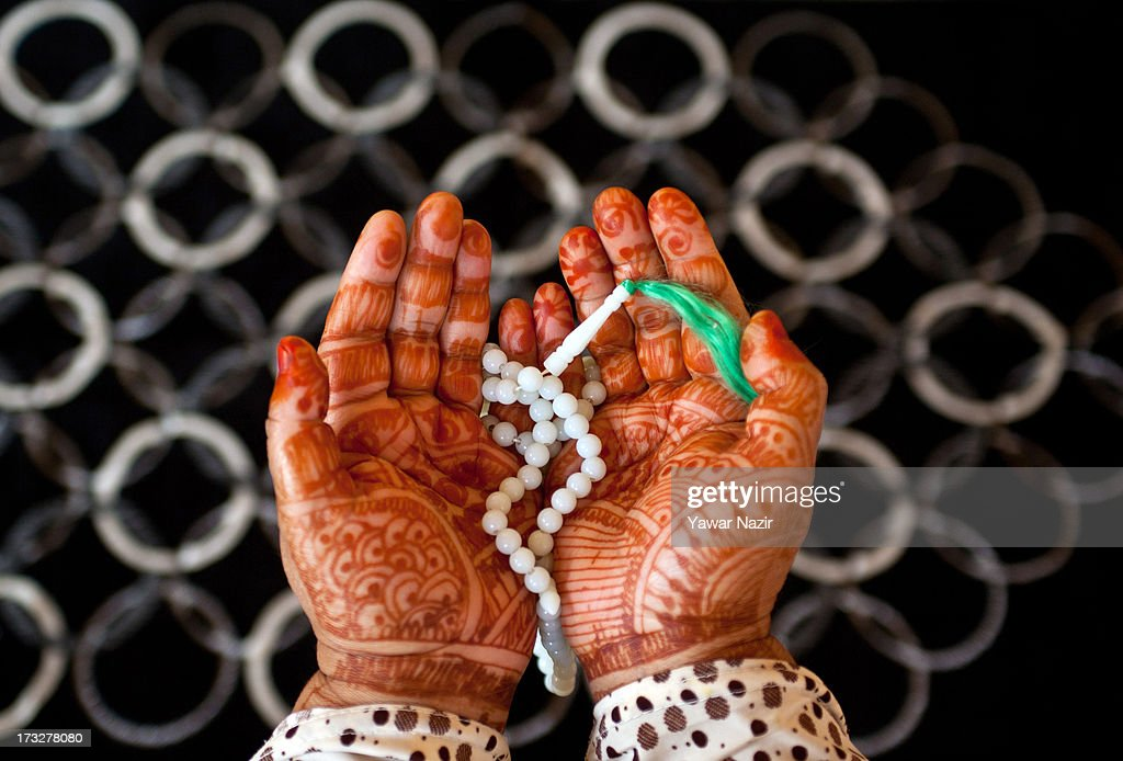 A Kashmiri Muslim woman with her hands decorated with henna prays on the first day of holy month of Ramadan on July 11, 2013 in Srinagar, the summer capital of Indian administered Kashmir, India. Ramadan is the ninth month of the Islamic lunar calendar, during which Muslims believe the Quran was given to Prophet Muhammad. Muslims across the globe abstain from eating, smoking, and sex from dawn to dusk during the month. Besides spending more time praying, donating alms is mandatory. Every Muslim has to give 2.5 percent of their wealth and assets to the poor, and often give more.