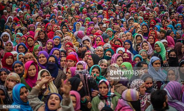 Kashmiri Muslim women attend the funeral of Rayees Ahmad a pro Kashmir rebel killed in a gun battle with Indian government forces is being consoled...