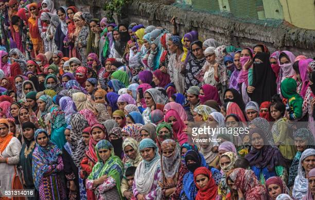 Kashmiri Muslim women attend the funeral of Yaseen Yatoo alias Mehmood Ghaznavi a local rebel commander killed in a gun battle with Indian government...