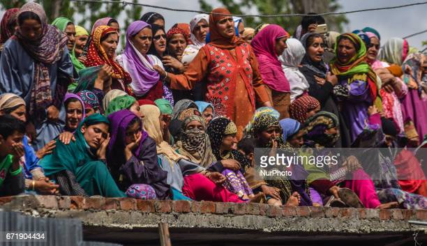 Kashmiri Muslim women attend the funeral procession of Younis Maqbool Ganie a pro Kashmir rebel killed in a gun battle with Indian government forces...