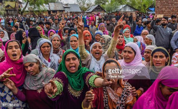 Kashmiri Muslim women chant anti Indian and pro Kashmir freedom slogans as they attend the funeral procession of Younis Maqbool Ganie a pro Kashmir...