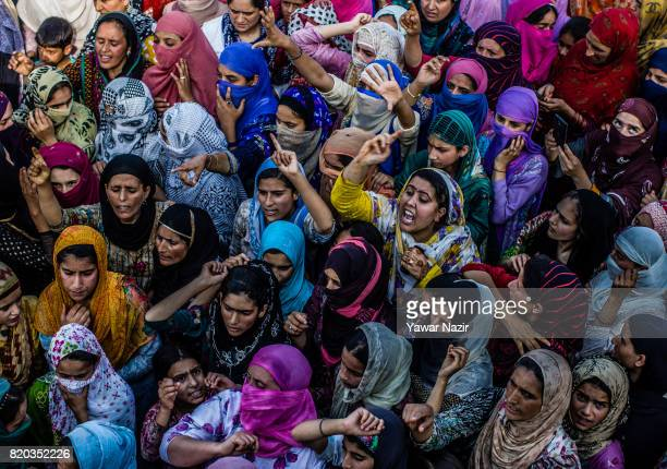 Kashmiri Muslim women chant antiIndian and proKashmir freedom slogans in front the body of Tanveer Ahmad Pala a civilian killed by Indian military...