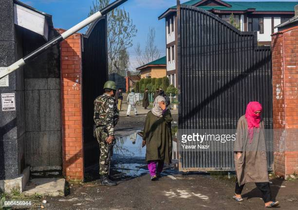 Kashmiri Muslim women come out of polling station after casting their votes during the elections of the lower house of Indian parliament on April 09...