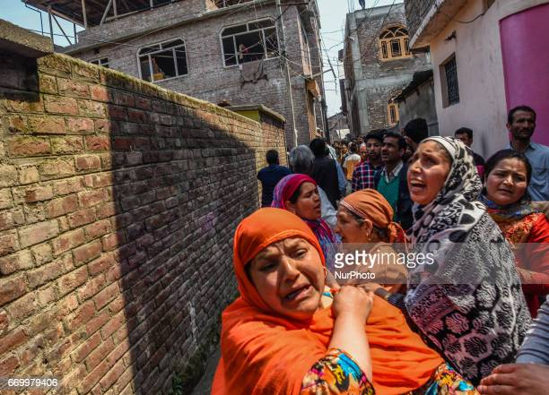 Kashmiri Muslim women cry on seeing their house engulfed in flames on APRIL 18 2017 in Srinagar the summer capital of Indian administered Kashmir...