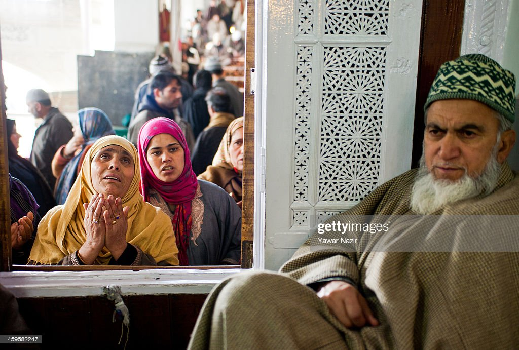 Kashmiri Muslim women devotees pray at the shrine of the Sufi saint Sheikh Hamza Makhdoom during a festival on December 28, 2013 in Srinagar, the summer capital of Indian administered Kashmir, India. Thousands of Kashmiri Muslims make the pilgrimage to the shrine of Sufi Saint Sheikh Hamza Makhdoomi, also known as Makhdoom Sahib, to offer prayers on the anniversary of his birth.