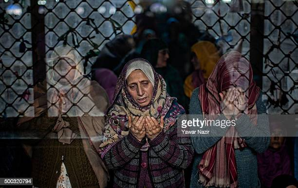 Kashmiri Muslim women devotees pray at the shrine of the Sufi saint Sheikh Hamza Makhdoom during a festival on December 07 2015 in Srinagar the...