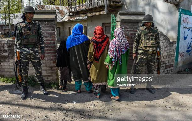 Kashmiri Muslim women enter a polling station to cast their votes where 201 votes were already casted by the locals during the reelections of the...