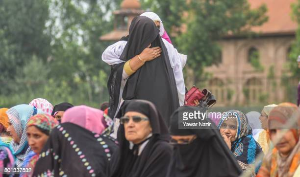 Kashmiri Muslim women hug each other before offering congregational EidulFitr prayers at Eid Gah on Eidulfitr a festival of Muslims on June 26 2017...