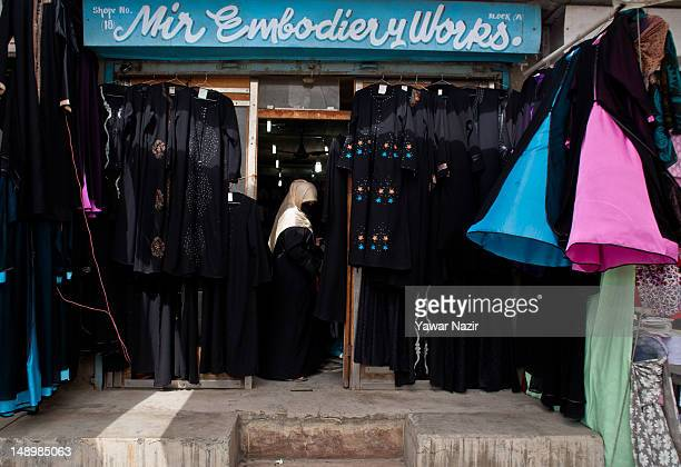 Kashmiri Muslim women look for a long tunic and veil or an abaya The traditional long black tunic covering the body from head to toe is always worn...