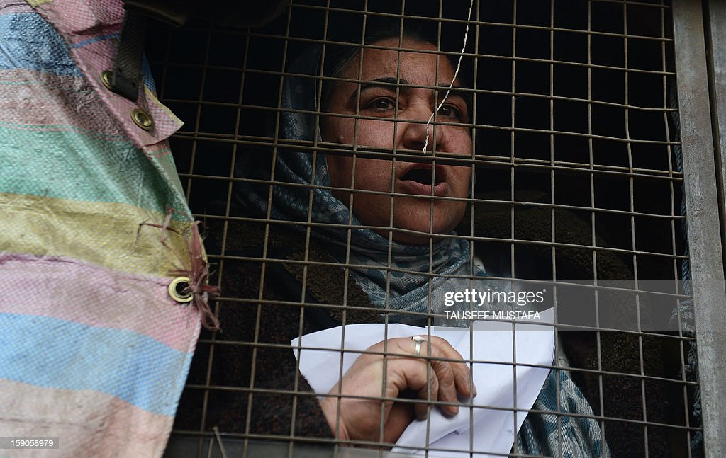 Kashmiri Muslim women look on from a police vehicle during a protest against a court verdict sentencing two Kashmiris to life imprisonment in Srinagar on January 7, 2013. The Muslim-majority region is in the grip of a 20-year insurgency against rule from New Delhi, which has left more than 47,000 people dead by the official count, a separatists put the toll twice as high. AFP PHOTO/ Tauseef MUSTAFA