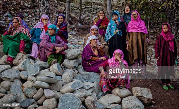 Kashmiri Muslim women look towards the body of Nissar Ahmad a Kashmiri militant killed in a gun battle between militants and Indian government forces...