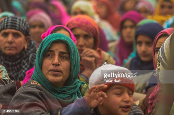 Kashmiri Muslim women mourn as they attend the funeral of Rayees Ahmad a pro Kashmir rebel killed in a gun battle with Indian government forces on...