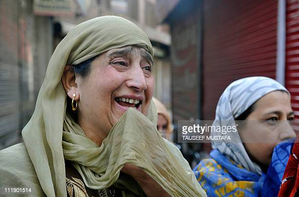 Kashmiri muslim women mourn during a funeral of a religious leader Moulana Shoukat Ahmad Shah in Srinagar on April 8 2011 A leading Muslim cleric and...