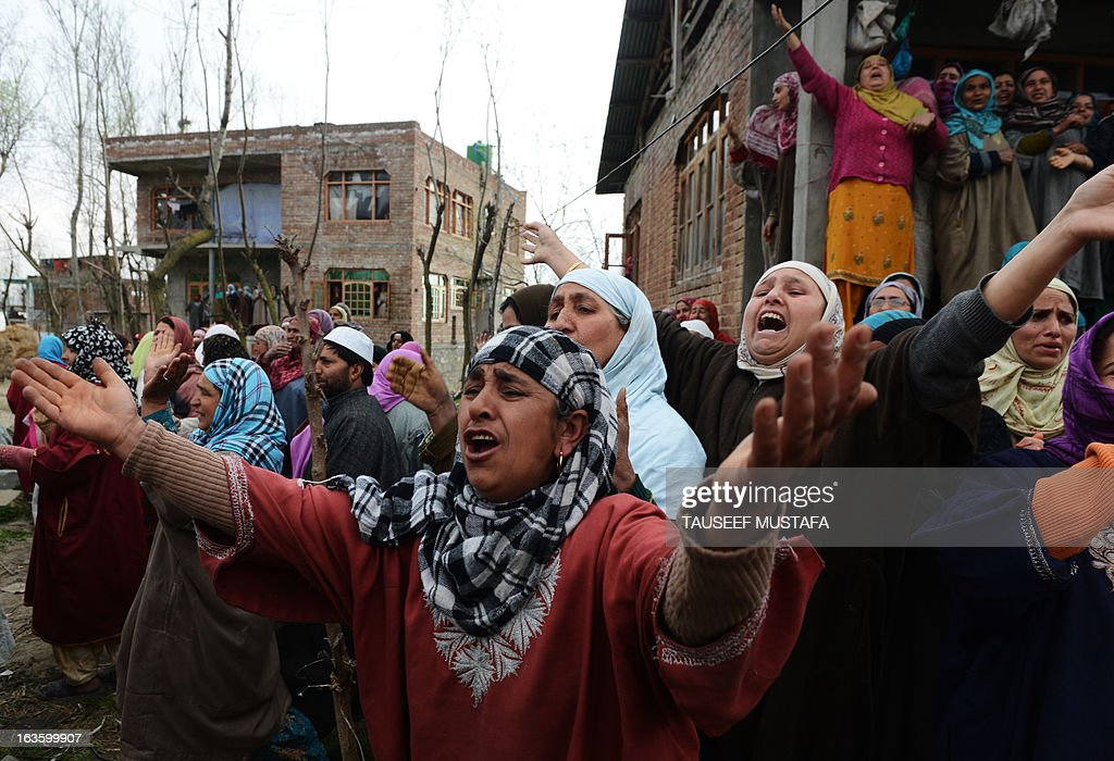 Kashmiri Muslim women mourn for Altaf Hussain Wani, 22, during a funeral procession in Srinagar on March 13, 2013. Wani died when Indian Paramilitary troopers allegedly fired at him when he was crossing the road in his neighbourhood eyewitness told AFP. Attacks in Srinagar have become rare in recent years with violence across the region at its lowest level since the insurgency began in 1989, boosting the vital local tourism industry. AFP PHOTO/ Tauseef MUSTAFA
