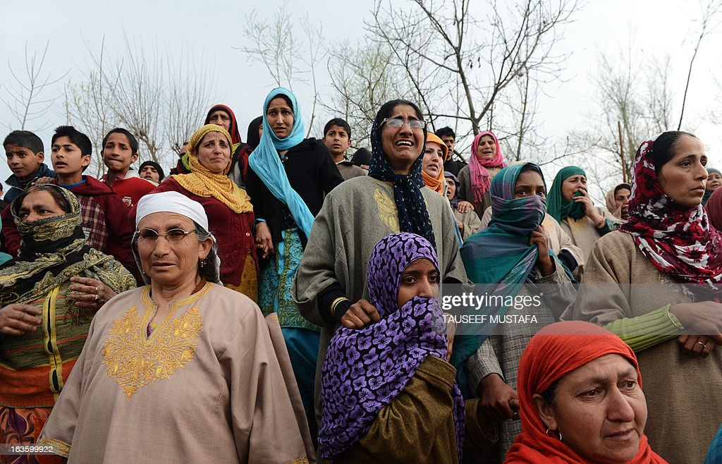 Kashmiri Muslim women mourn for Altaf Hussain Wani, 22, during a funeral procession in Srinagar on March 13,2013. Wani died when Indian Paramilitary troopers allegedly fired at him when he was crossing the road in his neighbourhood eyewitness told AFP. Attacks in Srinagar have become rare in recent years with violence across the region at its lowest level since the insurgency began in 1989, boosting the vital local tourism industry. AFP PHOTO/ Tauseef MUSTAFA
