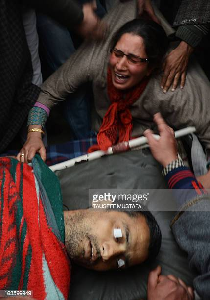 Kashmiri Muslim women mourn for Altaf Hussain Wani during a funeral procession in Srinagar on March 13 2013 Wani died when Indian Paramilitary...