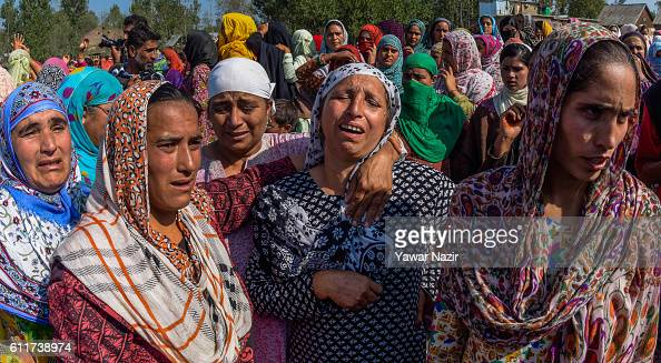 Kashmiri Muslim women mourn on seeing the body of Muzaffar Ahmad Pandit who succumbed to his injuries during his funeral on October 01 2016 in Check...
