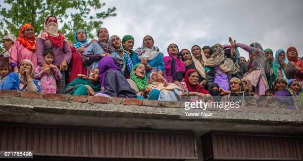 Kashmiri Muslim women mourn on seeing the body of Younis Maqbool Ganie a pro Kashmir rebel killed in a gun battle with Indian government forces...