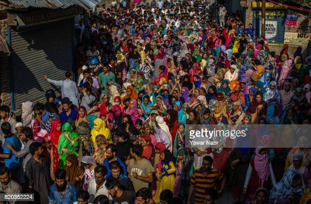 Kashmiri Muslim women participate in the funeral procession of Tanveer Ahmad Pala a civilian killed by Indian military forces during his funeral on...