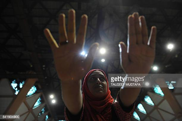 Kashmiri Muslim women practice yoga during a session to mark the International Yoga Day in Srinagar on June 21 2016 The ancient Indian practice of...
