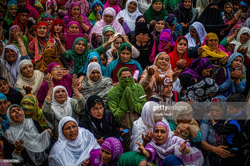 Kashmiri Muslim women pray as a head priest displays the holy relic believed to be the whisker from the beard of the Prophet Mohammed on the occasion of the Muslim festival Mehraj-u-Alam, which marks ascension day, the journey from earth to heavens of the Prophet Mohammed, at the Hazratbal Shrine on May 05, 2016 in Srinagar, the summer capital of Indian administered Kashmir, India. Every year thousands of Muslim devotees from across Kashmir throng the Hazratbal shrine in central Srinagar for prayers and to have a glimpse of the Moi-e-Muqaddas, Holy Relic of Prophet Mohammed, displayed for public viewing on ten occasions in a year , including Meraj-ul Alam , the night Muslims believe Prophet Mohammed ascended to the heaven.
