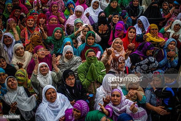Kashmiri Muslim women pray as a head priest displays the holy relic believed to be the whisker from the beard of the Prophet Mohammed on the occasion...
