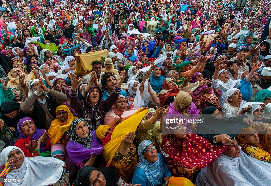 Kashmiri Muslim women pray as a head priest displays the holy relic believed to be the whisker from the beard of the Prophet Mohammed at the...