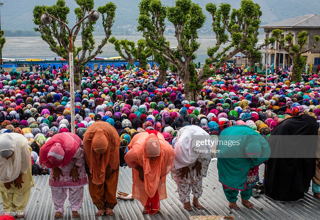 Kashmiri Muslim women pray at the Hazratbal Shrine on the Friday following MehrajuAlam which marks ascension day the journey from earth to heavens of...
