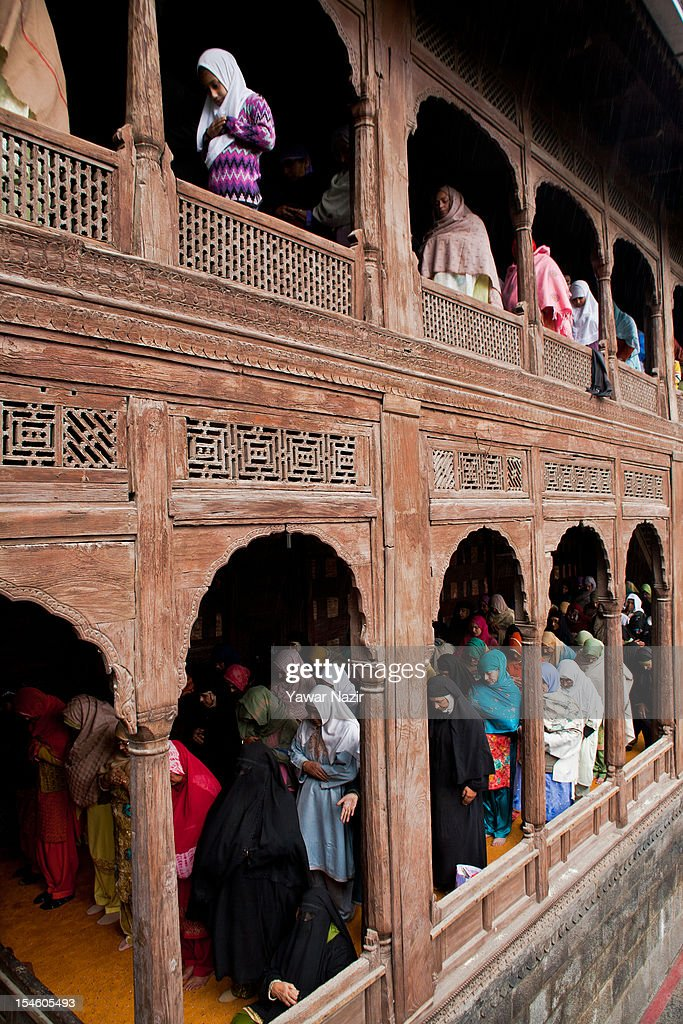 Kashmiri Muslim women pray at the shrine of Khaniqahi mullah during a festival on October 23, 2012 in Srinagar, the summer capital of Indian administered Kashmir, India. Thousands of Muslims thronged to the shrine of Mir Syed Ali Hamadan to commemorate the anniversary of the death of the Sufi saint, Hamadan. He is believed to be responsible for the spread of Islam in Kashmir. The shrine gains a special significance on 6th of Zilhaj (last month of Muslim calendar), the death anniversary of Mir Syed Ali Hamadan. On this day, devotees visit the shrine in large numbers to pay a tribute to saint Hamadan.