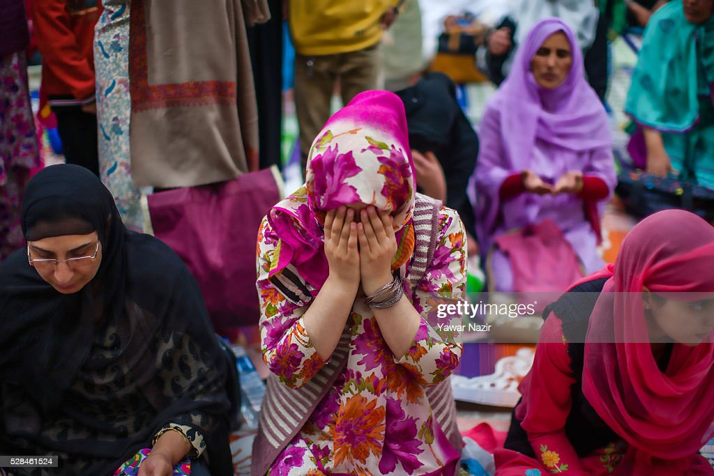 Kashmiri Muslim women pray outside the Hazratbal Shrine on the MehrajuAlam which marks ascension day the journey from Earth to Heaven of the Prophet...