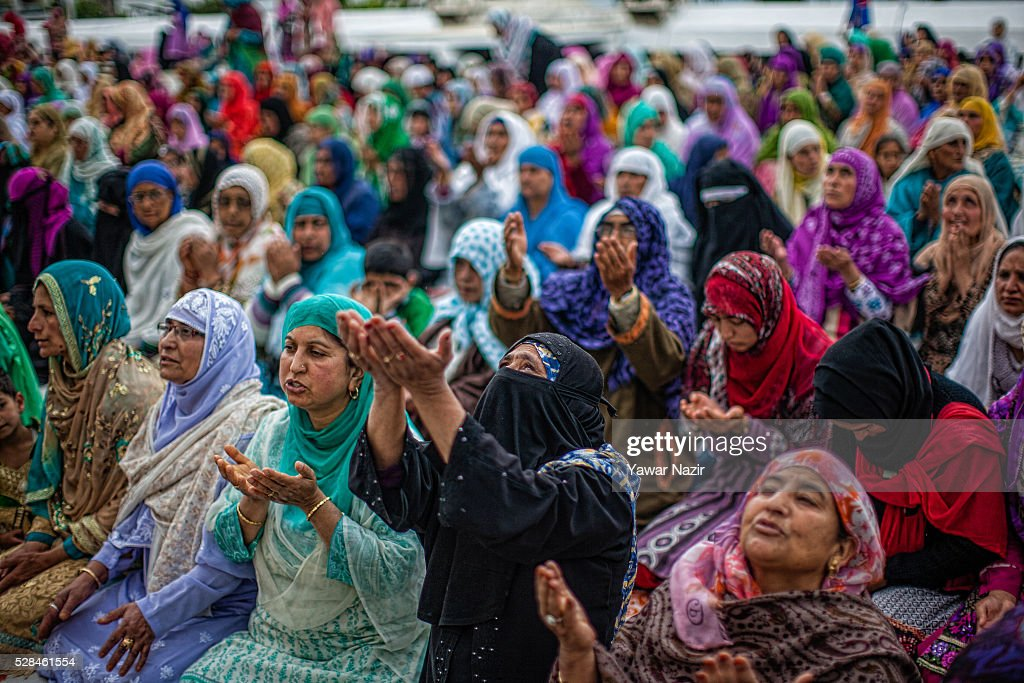 Kashmiri Muslim women pray outside the Hazratbal Shrine on the Mehraj-u-Alam, which marks ascension day, the journey from Earth to heavens of the Prophet Mohammed, at the on May 05, 2016 in Srinagar, the summer capital of Indian administered Kashmir, India. Every year thousands of Muslim devotees from across Kashmir throng the Hazratbal shrine in central Srinagar for prayers and to have a glimpse of the Moi-e-Muqaddas, Holy Relic of Prophet Mohammed, displayed for public viewing on ten occasions in a year , including Meraj-ul Alam , the night Muslims believe Prophet Mohammed ascended to the heaven.