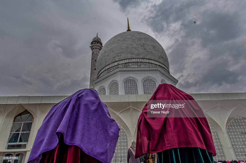 Kashmiri Muslim women pray outside the Hazratbal Shrine on the Mehraj-u-Alam, which marks ascension day, the journey from earth to heaves of the Prophet Mohammed, at the on May 05, 2016 in Srinagar, the summer capital of Indian administered Kashmir, India. Every year thousands of Muslim devotees from across Kashmir throng the Hazratbal shrine in central Srinagar for prayers and to have a glimpse of the Moi-e-Muqaddas, Holy Relic of Prophet Mohammed, displayed for public viewing on ten occasions in a year , including Meraj-ul Alam , the night Muslims believe Prophet Mohammed ascended to the heaven.