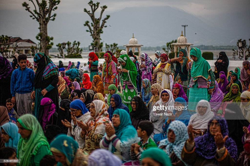 Kashmiri Muslim women pray outside the Hazratbal Shrine on the MehrajuAlam which marks ascension day the journey from Earth to heavens of the Prophet...