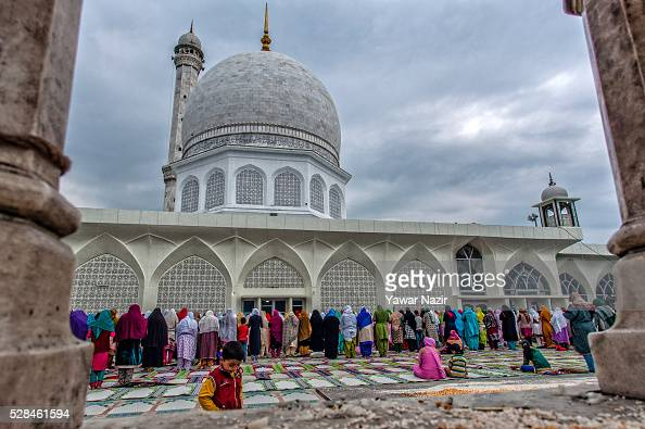 Kashmiri Muslim women pray outside the Hazratbal Shrine on the MehrajuAlam which marks ascension day the journey from earth to heaves of the Prophet...