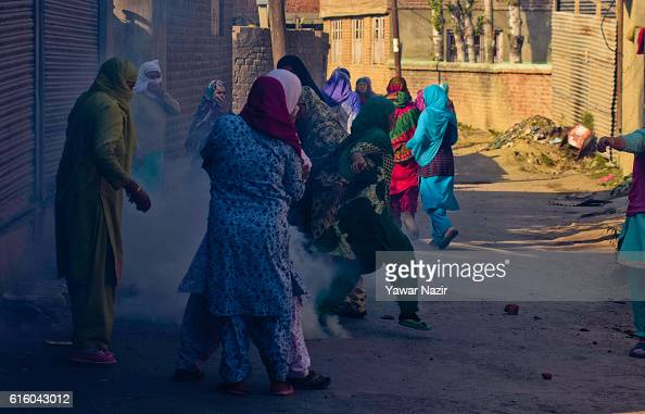 Kashmiri Muslim women save themselves from the teargas canister lobbed at them by Indian government forces during an antiIndia protest on October 21...