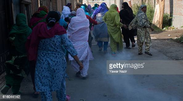 Kashmiri Muslim women save themselves from the teargas canister lobbed at them by Indian government forces during an anti India protest on October 21...