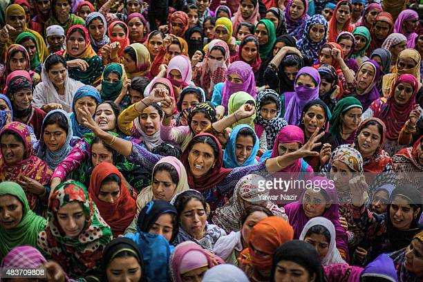 Kashmiri Muslim women shout anti Indian and pro Kashmir freedom slogans as they mourn during the funeral of Bilal Ahmad Bhat a civilian who was...