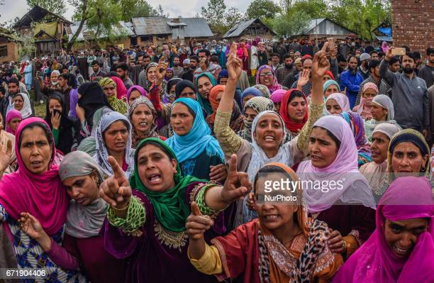 Kashmiri Muslim women shout anti Indian and pro Kashmir freedom slogans as they attend the funeral procession of Younis Maqbool Ganie a pro Kashmir...