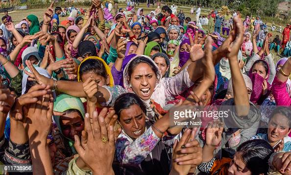 Kashmiri Muslim women shout anti Indian and pro Kashmir freedom slogans during the funeral of Muzaffar Ahmad Pandit who succumbed to his injuries...
