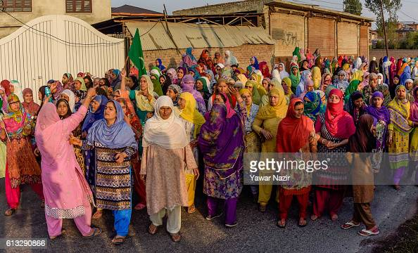 Kashmiri Muslim women shout anti Indian slogans as they attend the funeral of Junaid Ahmad who was reportedly killed by Indian government forces...
