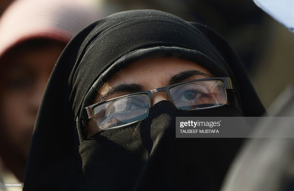 Kashmiri Muslim women shout anti Indian slogans during a protest against a court verdict sentencing two Kashmiris to life imprisonment in Srinagar on January 7, 2013. The Muslim-majority region is in the grip of a 20-year insurgency against rule from New Delhi, which has left more than 47,000 people dead by the official count, a separatists put the toll twice as high. AFP PHOTO/ Tauseef MUSTAFA