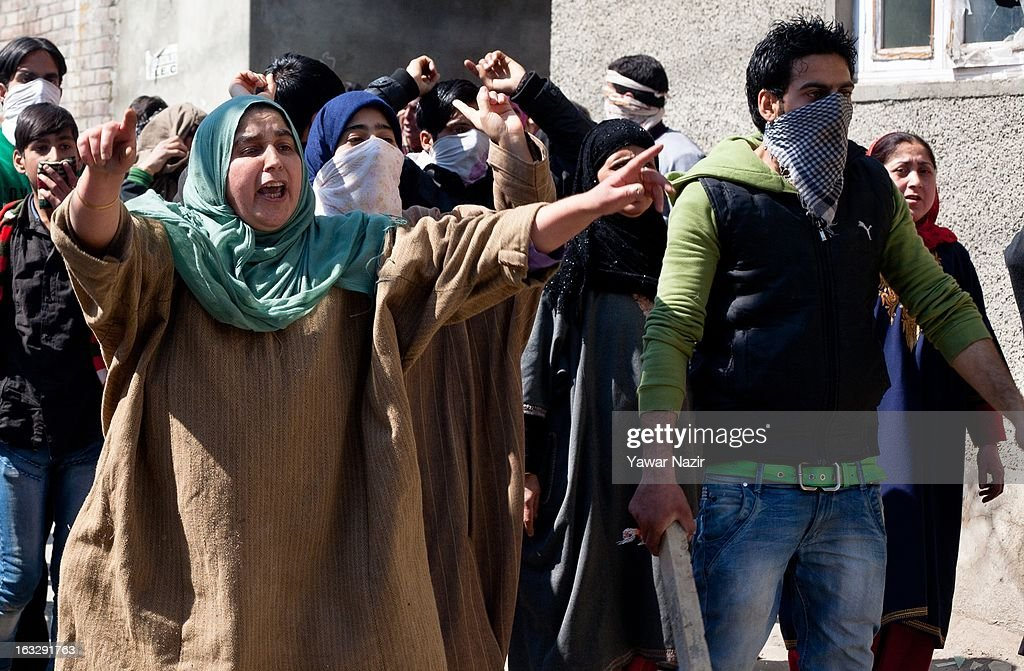 Kashmiri Muslim women shout anti-Indian and pro-freedom slogans during a curfew-like restriction on March 7, 2013 in Srinagar, the summer capital of Indian Administered Kashmir, India. Clashes erupted in most parts of Kashmir today leaving scores of people injured. Meanwhile Indian authorities imposed curfew-like restrictions for the second consecutive day in most parts of Kashmir following the killing of a Kashmiri youth by the Indian army in North Kashmir's Baramulla district.