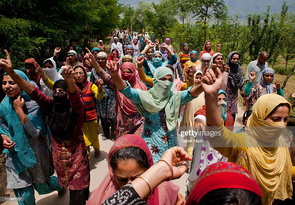 Kashmiri Muslim women shout anti-Indian slogans during a funeral of Tariq Ahmad, a civilian who was killed by Indian army on June 30, 2013 in Kondebal 25 km (15 miles) north of Srinagar the summer capital of Indian administered Kashmir, India. A teenage boy, identified as Irfan Ahmad Ganaie was killed during a search operation by Indian police in the village of Markondal in Bandipora District, before dawn on Sunday. A second person, Tariq Ahmad Leharwal, was killed after the Indian army shot at local residents who were protesting the earlier deadly incident. The killings triggered mass protests in the area.