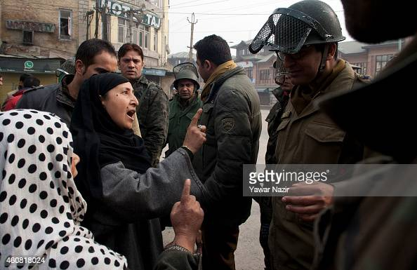 Kashmiri Muslim women shout at Indian police officer after clashes between supporters of Jammu and Kashmir Liberation Front on December 24 2014 in...