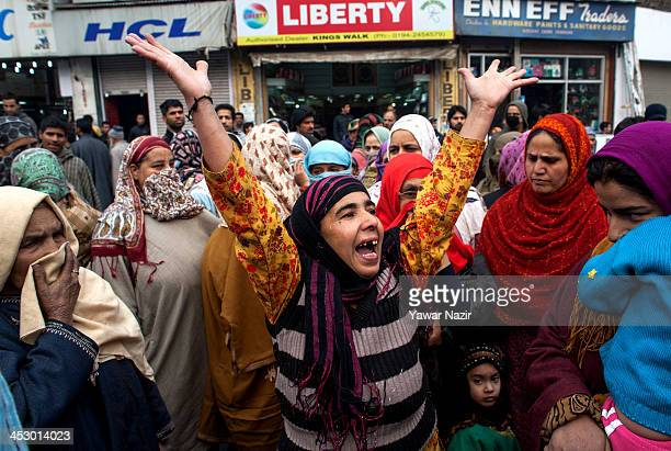 Kashmiri Muslim women shout slogans during a protest against erratic cuts in power supplies in the city centre on December 02 in Srinagar the summer...