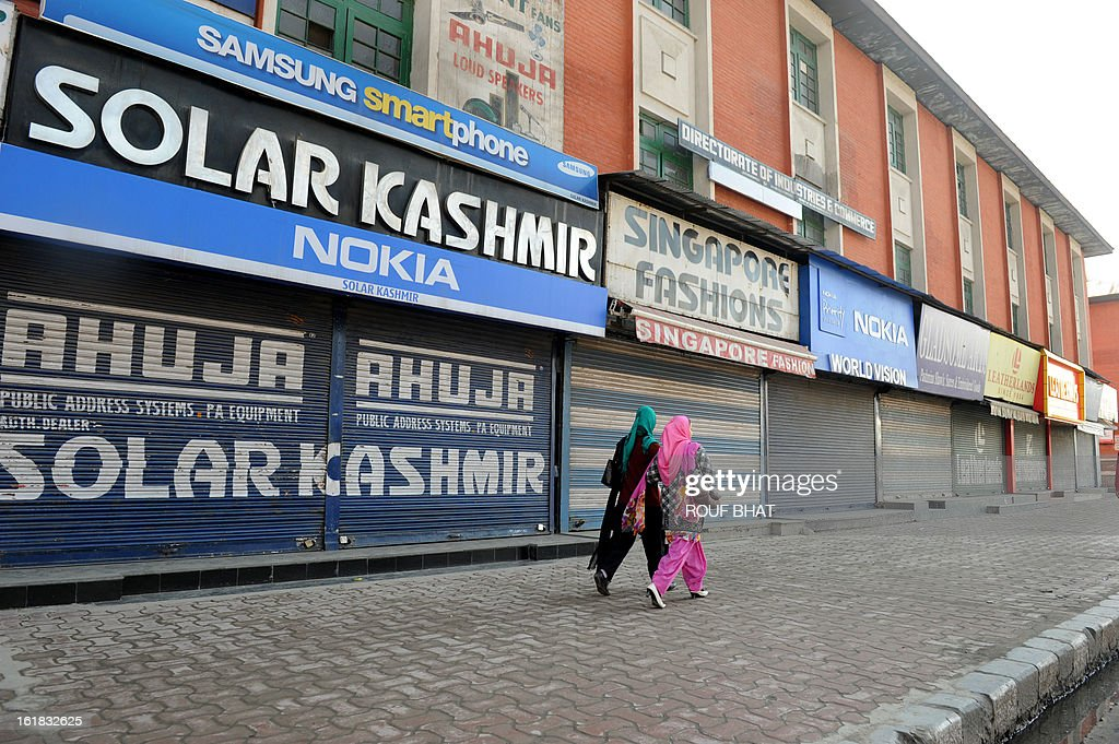 Kashmiri Muslim women walk in front of shuttered shops during the second day of strike in Srinagar on February 17, 2013. Kashmiri Hurriyat leader Syed Ali Gilani called a two-day strike in Kashmir to protest against the execution of Kashmiri Muslim separatist Mohammed Afzal Guru at a high security prison in New Delhi over his role in a deadly attack on Indian parliament in New Delhi in 2001. AFP PHOTO/ Rouf BHAT