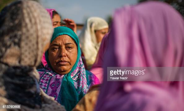 Kashmiri Muslim women weep on seeing the body of Junaid Ahmad who was reportedly killed by Indian government forces during his funeral on October 08...